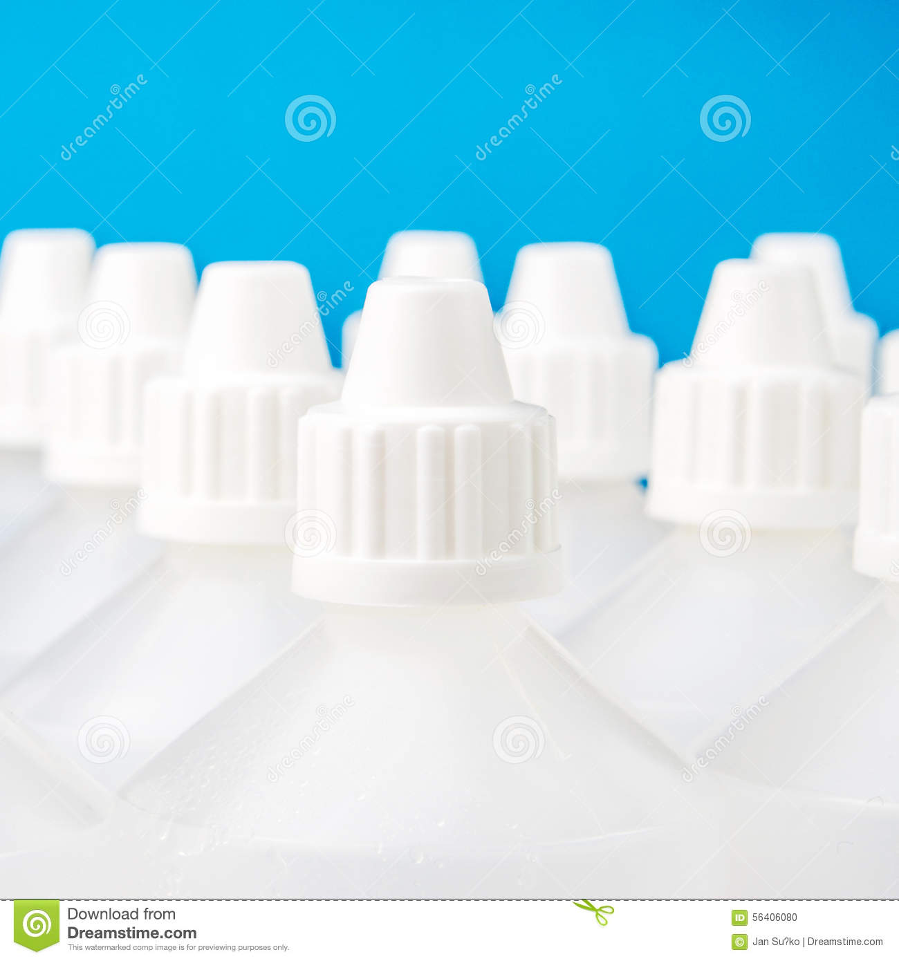 ... one specific focused bottle on blue and blurred bottles background
