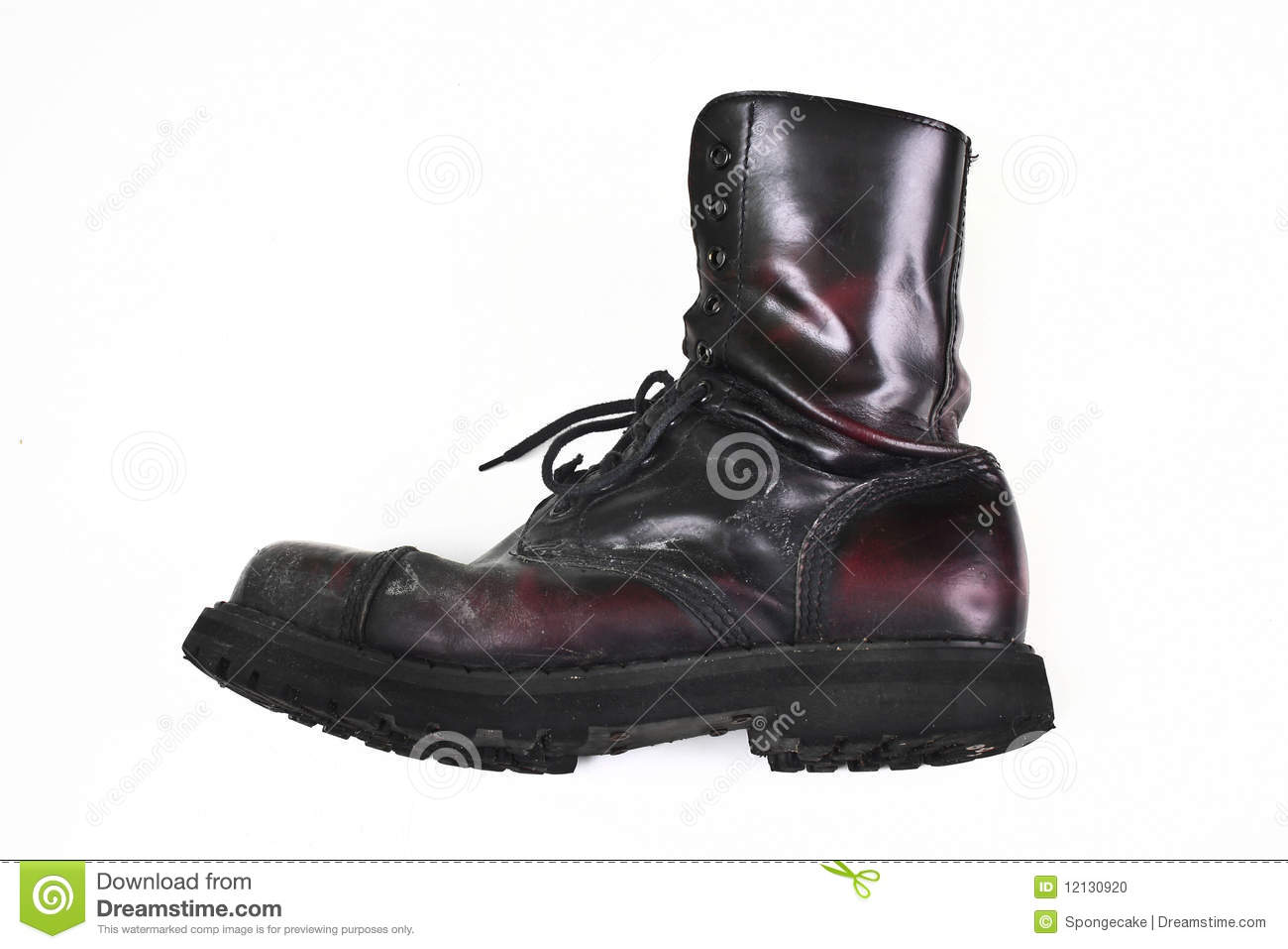 Dusty combat boot on white background.