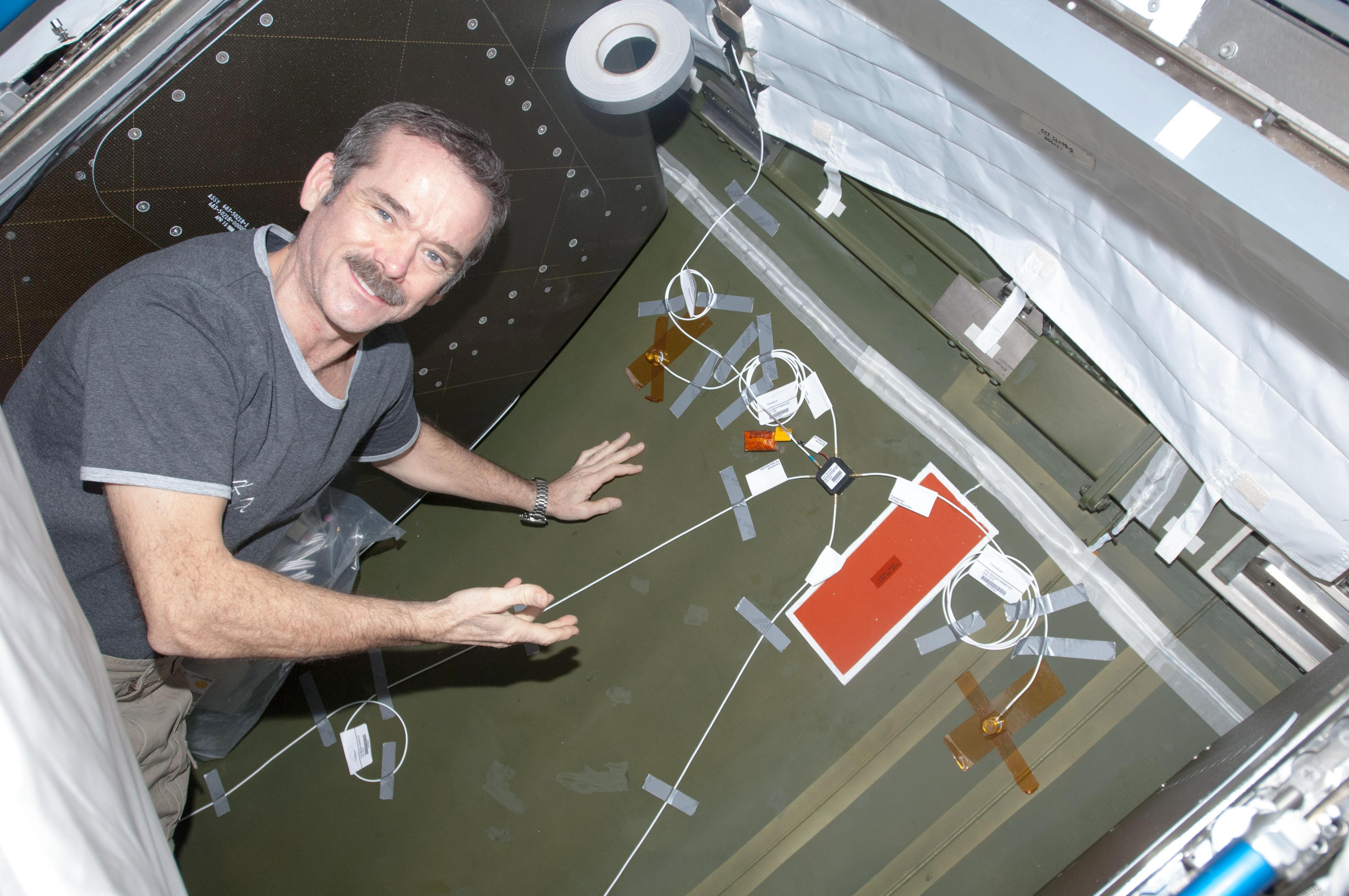 ... Hadfield installing Ultra-Sonic Background Noise Tests (UBNT) sensors