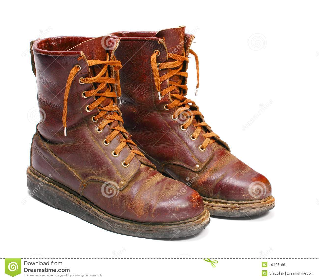 Old army paratroopers combat boots on white background.