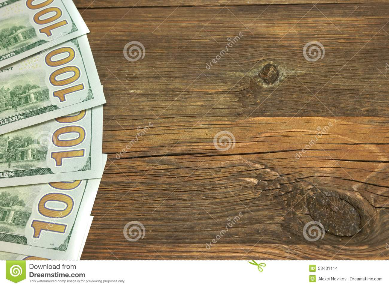 Five One Hudred Dollar Bill On The Rough Wood Background Stock Photo ...