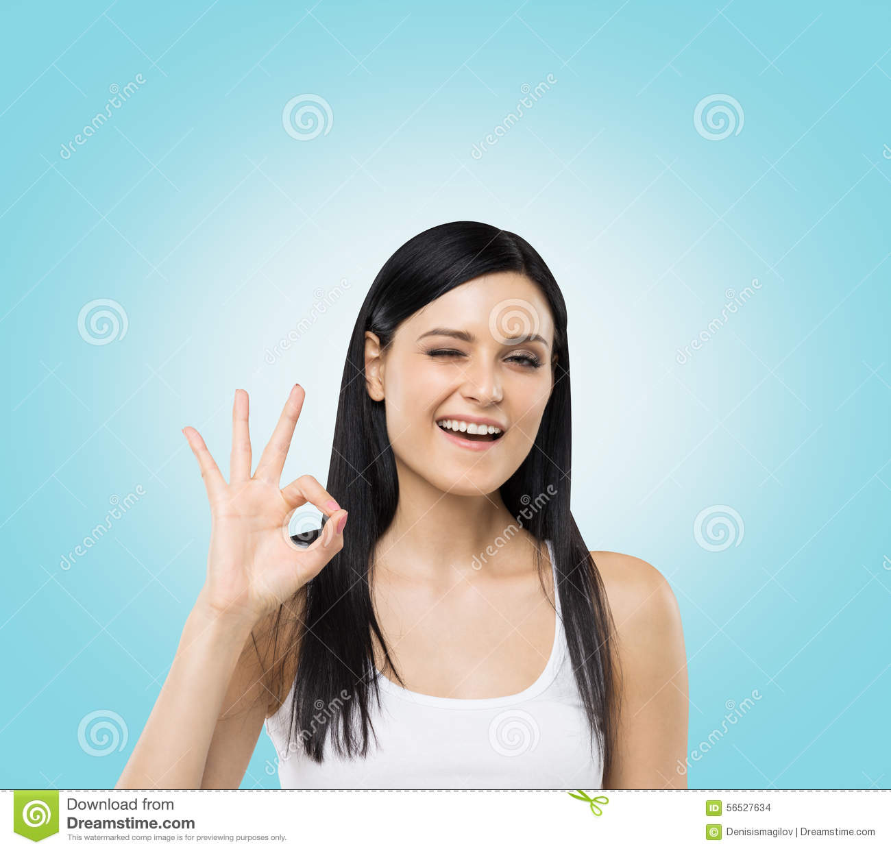 Woman Shows Ok Sign. Blue Background. Stock Photo - Image: 56527634