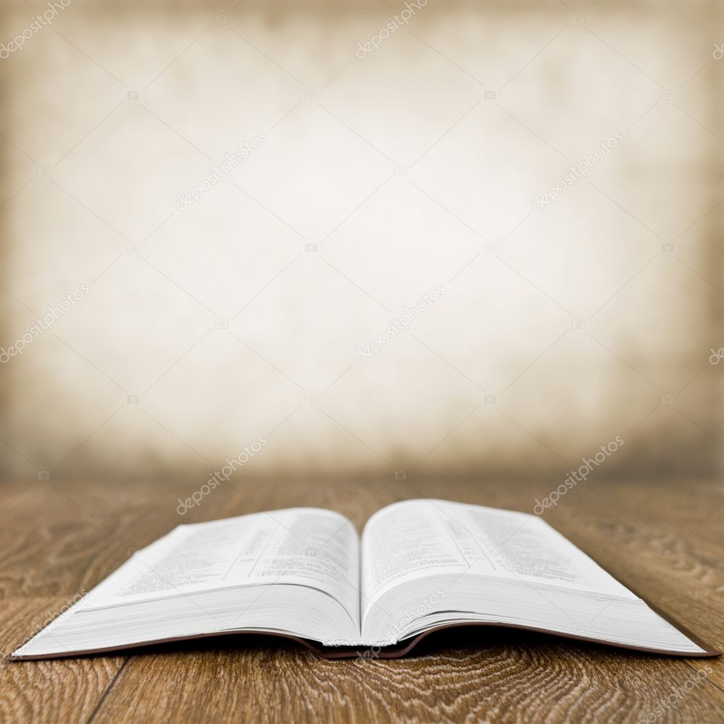 Open book on wood table over grunge background — Stock Photo ...